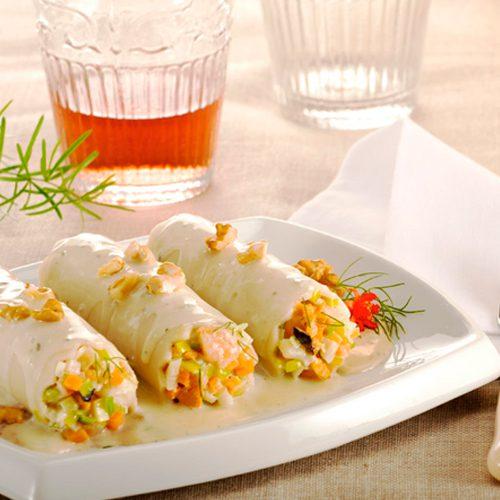 Canelones de marisco sobre coulís de setas, gorgonzola y nueces